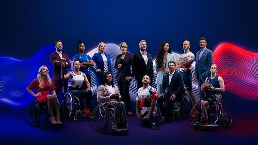 Image shows all Channel 4 Paralympic Presenters in a studio setting, the background is purple with blue and red wave images.