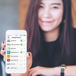 Easy Reader display on smartphone, held by a smiling girl
