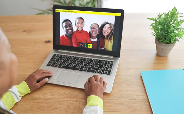 GuideConnect user Video Calls their family on a laptop