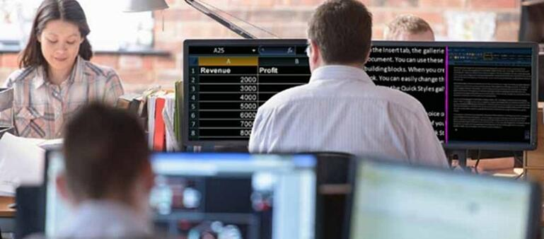 Image shows SuperNova screen magnifier being used in a busy office environment