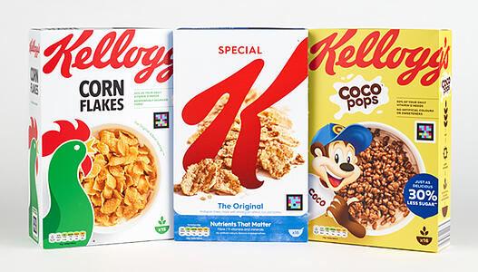 Image shows 3 boxes of Kellogg's cereals (Cornflakes, Special K and Cocopops) The NaviLens barcodes are displayed on the front of each pack.