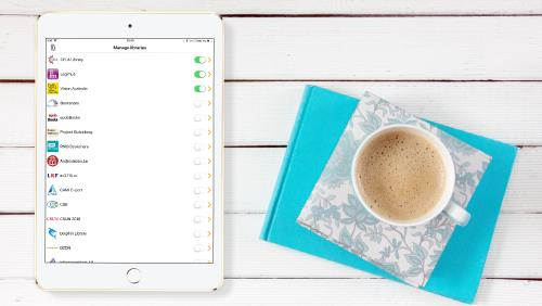 Image shows EasyReader Libraries list displayed on an iPad screen, next to a cup of coffee